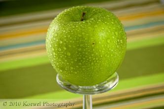 Apple on wine glass