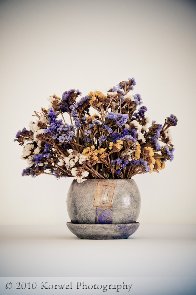 Bouquet of colorful dried sea lavender (Limonium) in matching jug