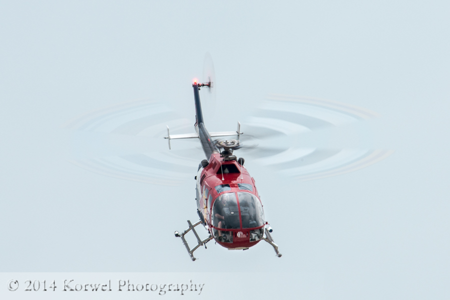 Chuck Aaron in Red Bull  helicopter. Airventure 2014